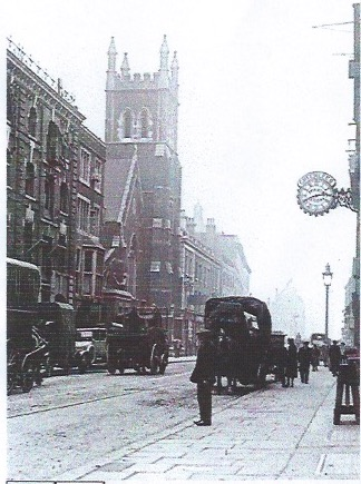 Commercial Street showing Toynbee Tower (bombed during WWII)